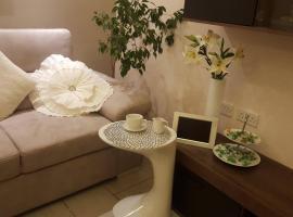 Foto di Hotel: REVIVE Luxury Spa Room