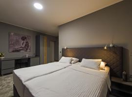 होटल की एक तस्वीर: Sobe Merlon