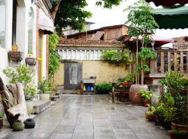 Hotel Foto: Huatian Gucuo Guesthouse
