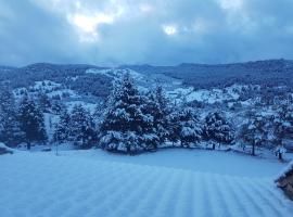Hotel photo: Acogedora casa en la montaña