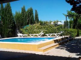 Foto di Hotel: Entre Olivos Casa y Cabaña