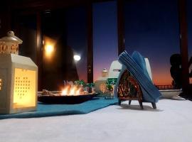 Foto di Hotel: Casa con vista mare