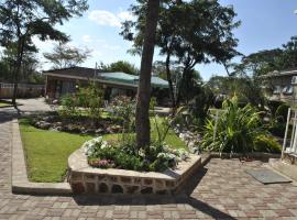 Hotel fotografie: Palm Leaf Gardens