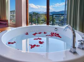 Fotos de Hotel: Lijiang YouLuJu Guesthouse