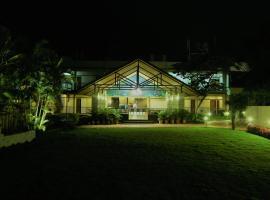 होटल की एक तस्वीर: Cotton County Club and Resort