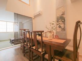 Hotel photo: Qingdao Laoshan·Stone Old Man Bathing Beach· Locals Apartment 00147500