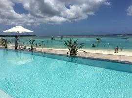 A picture of the hotel: Trou'O'Biches Luxury Beachfront Apartments
