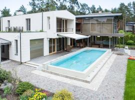 Hotel photo: Exclusive, modern house by river in Jūrmala