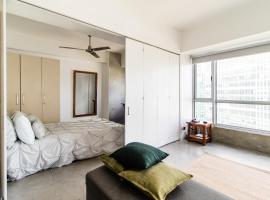 Hotel photo: 1BR BGC Condo Across Uptown Mall- FAST FiberInternet/Google Home