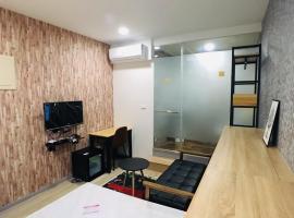 Hotel photo: 北歐輕工業風雙人床套房/台北101/動物園/政治大學/文山區