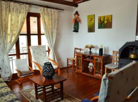 Hotel photo: Cosy wooden house