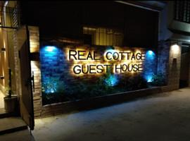 Foto di Hotel: Real Cottage Guest House