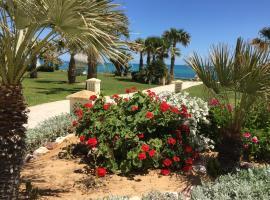 Hotel Foto: Pieds dans l'eau avec grand jardin