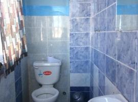 Foto di Hotel: Acogedora habitación con baño privado