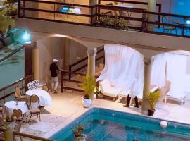 Фотографія готелю: L'Extase Hotêl