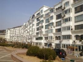 Фотография гостиницы: Qingdao Dusco Holiday Apartment Shilaoren Park