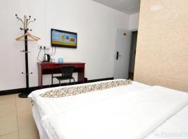 A picture of the hotel: Guangzhou Jiu Ri Business Apartment