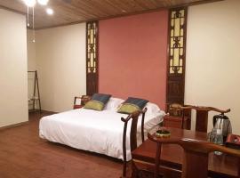 A picture of the hotel: Wutong Yinxiang Inn