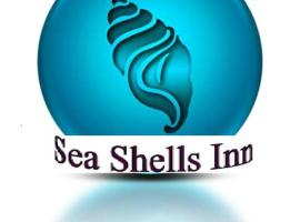 Hotel Foto: Sea Shells Inn
