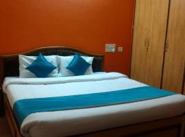 होटल की एक तस्वीर: Omkar Rooms