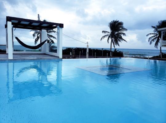 Hotel foto 's: Front Beach Luxury House w/ Infinity Pool
