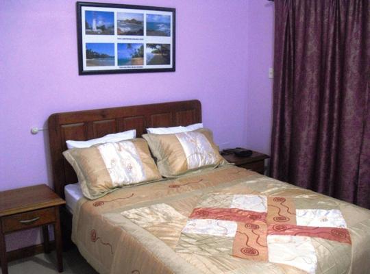 Фотографії готелю: Piarco Village Suites