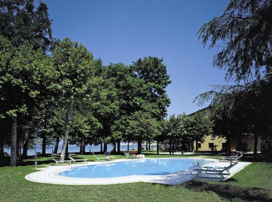 Φωτογραφίες του ξενοδοχείου: Hotel Lugana Parco Al Lago