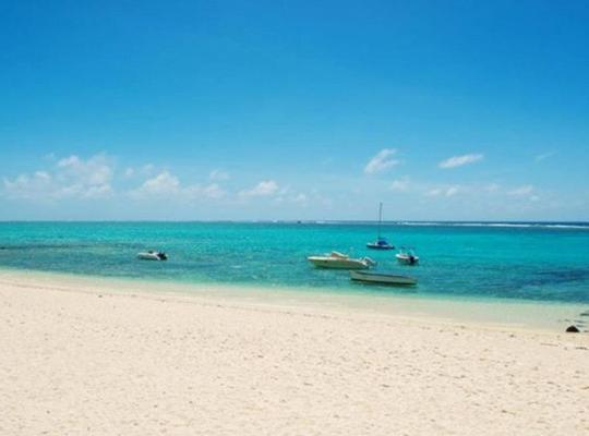 होटल तस्वीरें: Coral Bay Beachfront Apartment