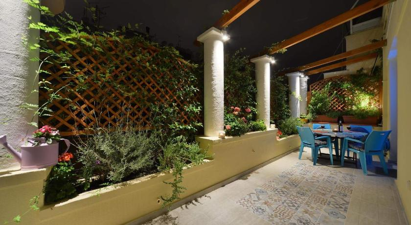 19fa09676d Best time to travel Greece Oasis veranda under columns.Kolonaki embassy  area.