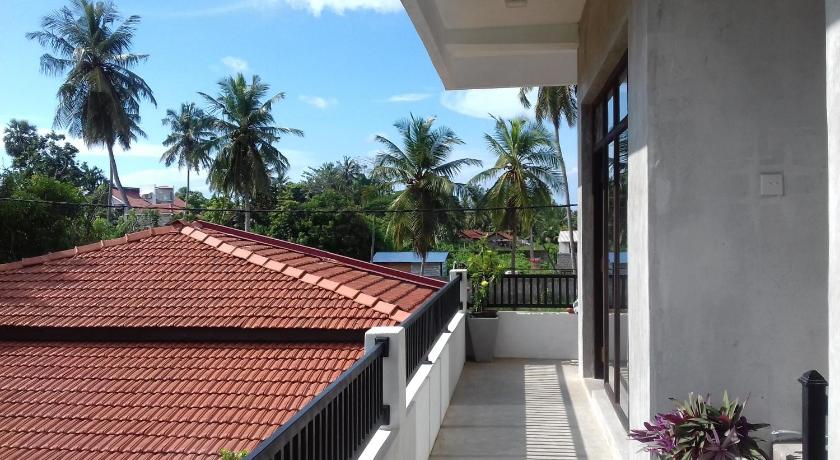 Deluxe Balcony Triple Room with Garden & Canal View