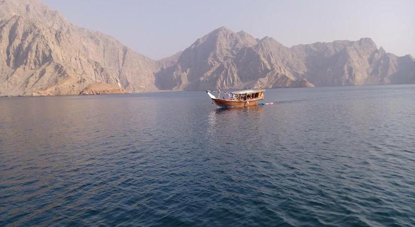 Best time to travel Oman Khasab beach tours camp