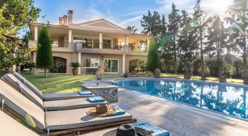 Luxury beachfront villa with pool Prices, photos, reviews