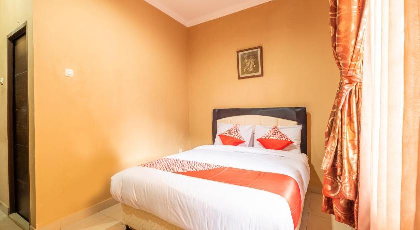 Kamar penginapan di OYO 1255 Homestay Casa Delray Syariah
