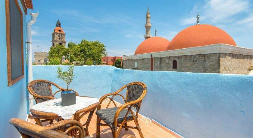Best time to travel Rhodes Old Town Roloi House