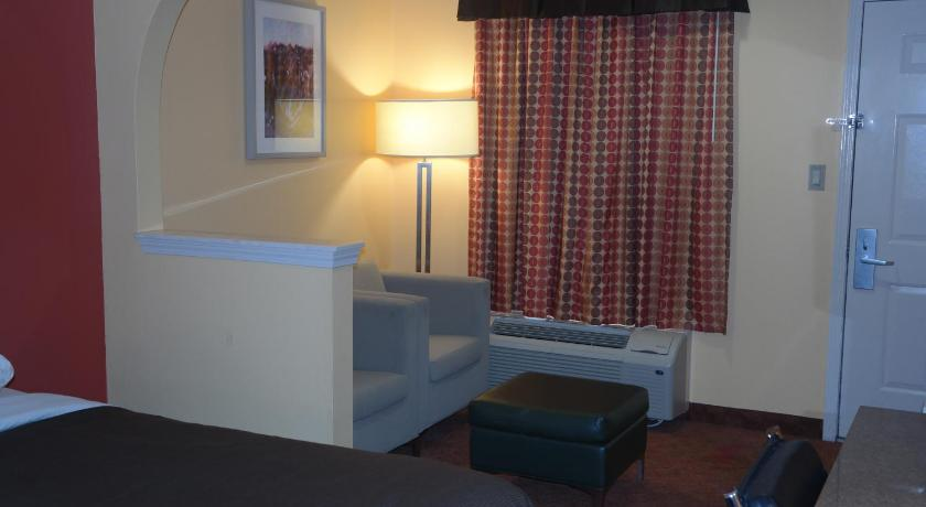Queen Room with Two Queen Beds Legacy Inn & Suites