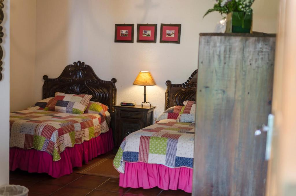 Double Room with Two Double Beds Hostal San Nicolas