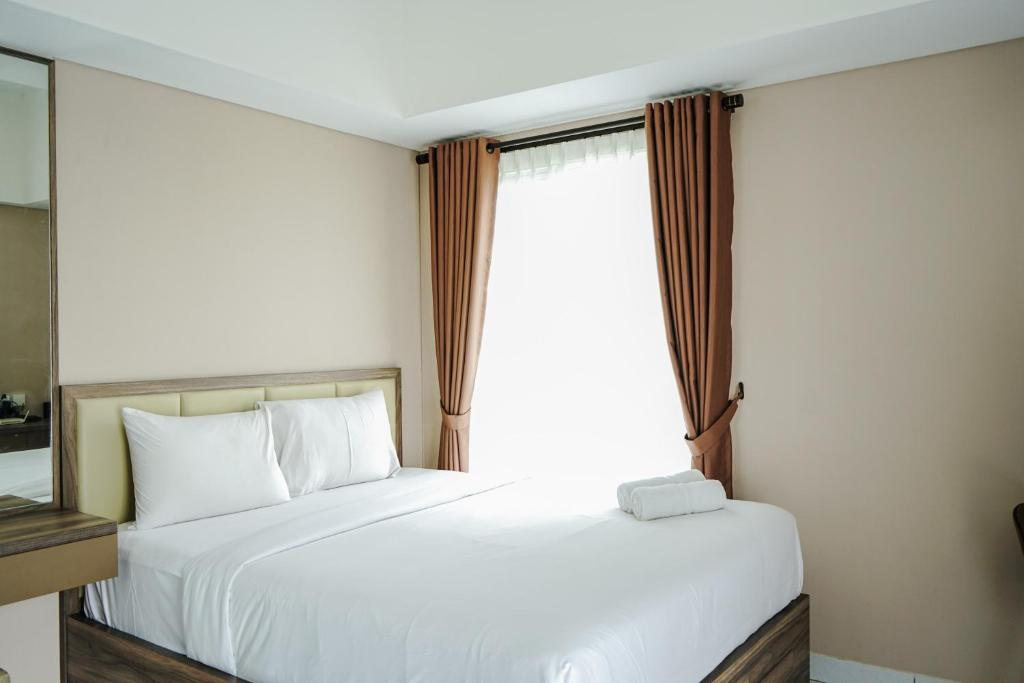 Affordable Studio Casa De Parco Apartment near AEON Mall By Travelio
