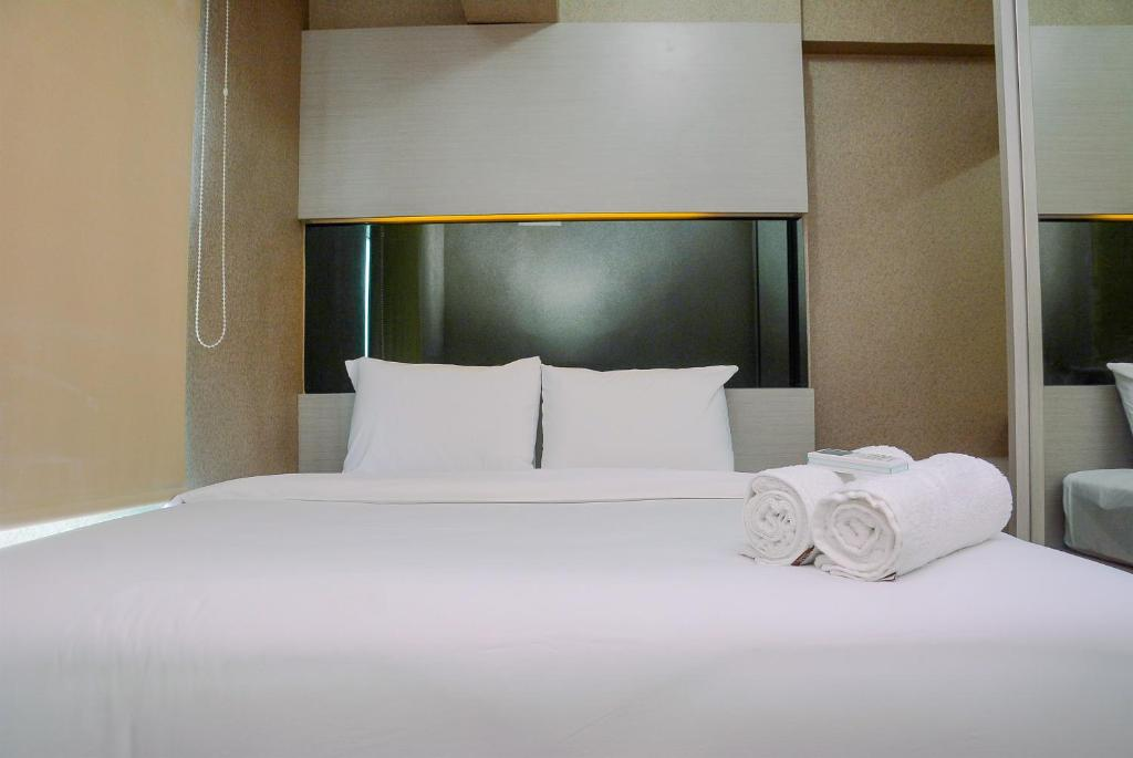 Sea View 2BR Apartment at Green Bay Pluit By Travelio