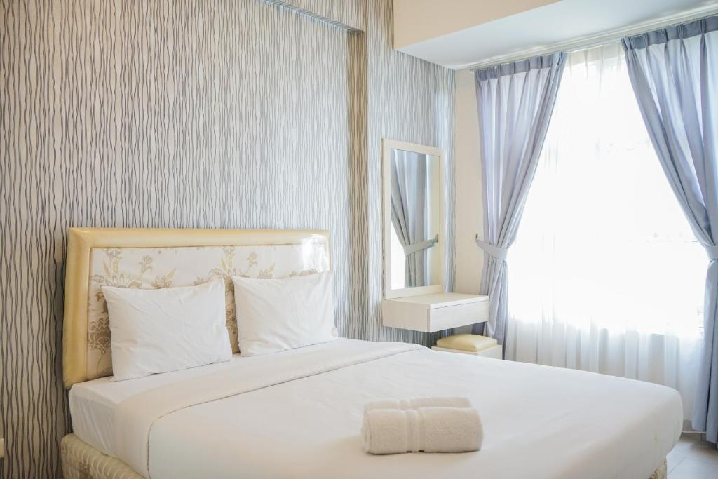 Best Price 1BR Apartment at Saveria near AEON Mall By Travelio