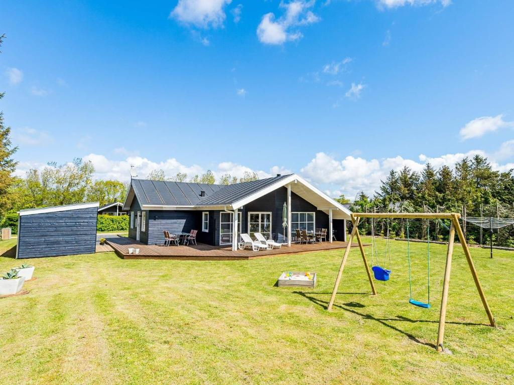 6 person holiday home on a holiday park in Tarm