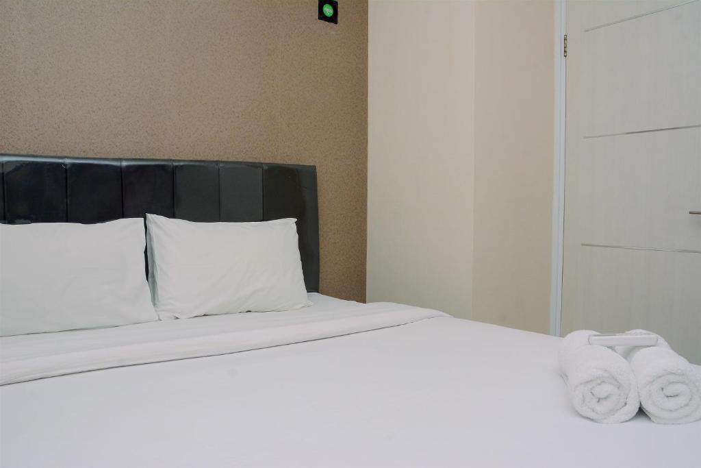 Minimalist 2BR Apartment at Green Pramuka By Travelio
