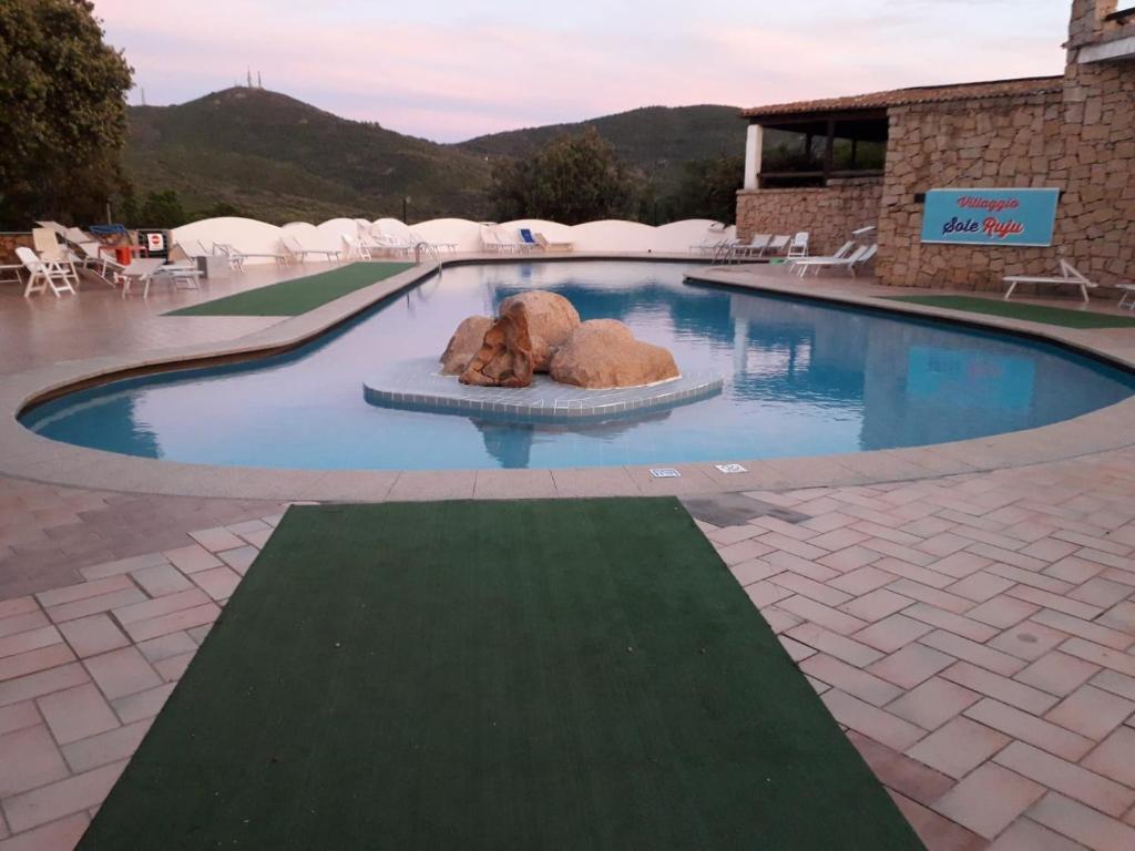 Appartamento Arianna con giardino e piscina