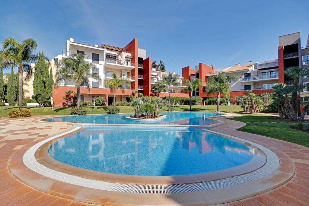 Vilamoura Palm Village with Pool by Homing