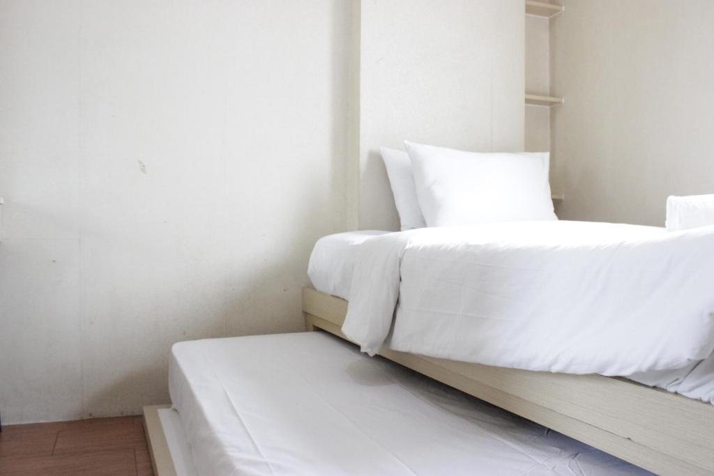 Private & Stylish 2BR at Gateway Apartment Ahmad Yani Cicadas By Travelio