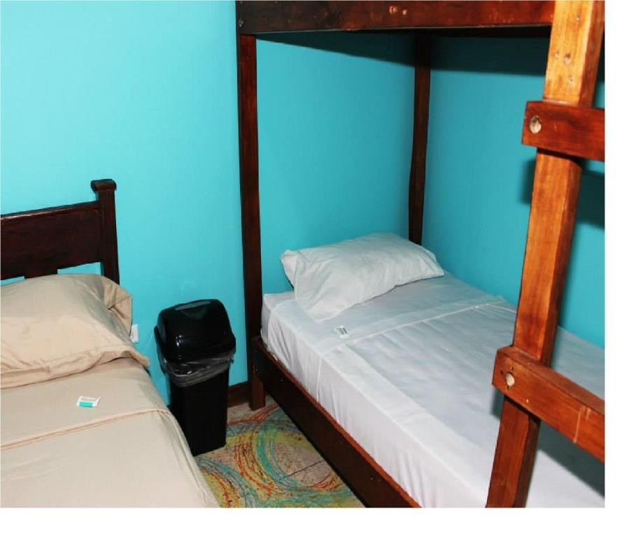 Basic Triple Room with Shared Bathroom Coral Reef Surf Hostel and Camp