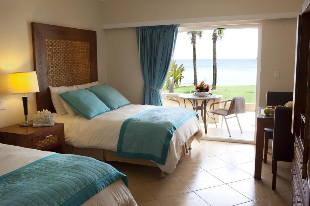 Double Guestroom- Beachtront All Inclusive Divi Little Bay Beach Resort