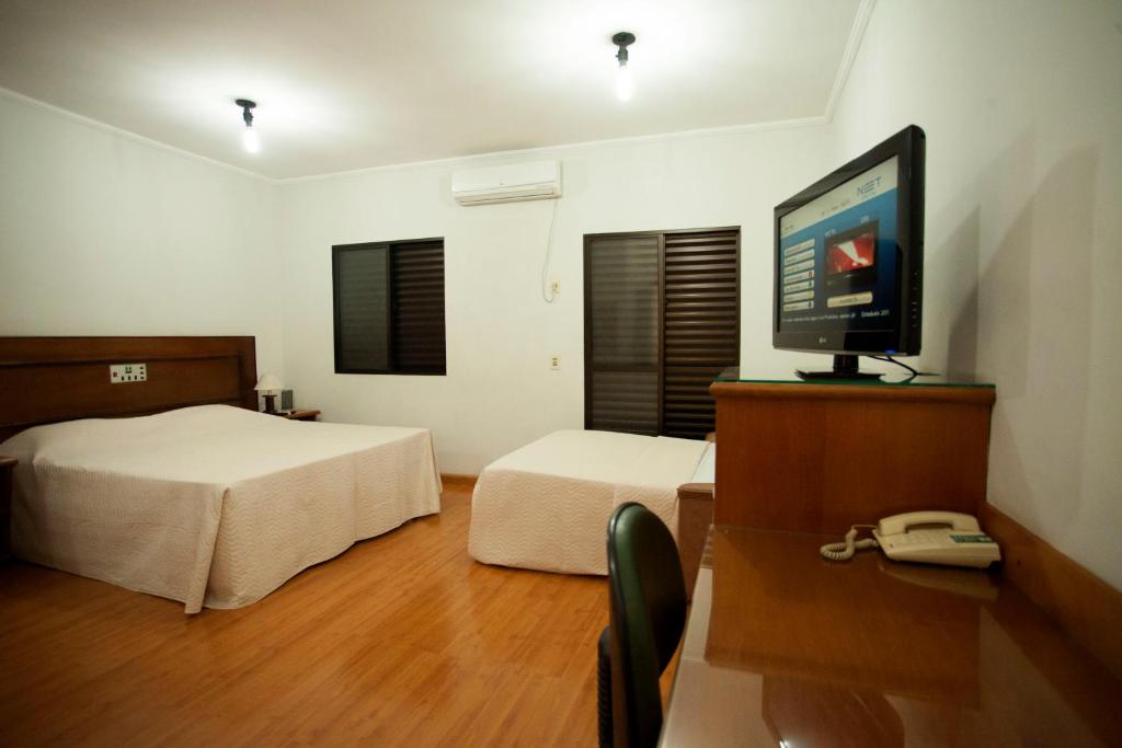 Habitació Triple Luxe Indaia Hotel Residence