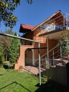 House with three Verandas