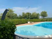 Appartamento Il Faro con giardino in Residence con piscina