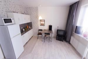 Apartment Ohtinskaya with balcony - Murino